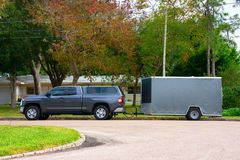 Residential work truck with a trailer for lawn maintenance and construction royalty free stock photography