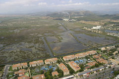 Residentials, protected wetland and industry aerial view. Aerial view of north side in the Spanish island of Mallorca, showing protected wetland lagoons on Stock Photos