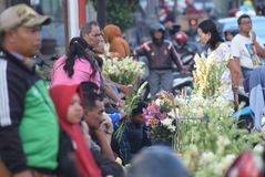 Selling Flowers at market. Residents buy flowers at Peterongan Market Semarang, Thursday June 14, 2018. The most delicious night flowers hunted by buyers of royalty free stock photo