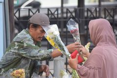 Selling Flowers at market. Residents buy flowers at Peterongan Market Semarang, Thursday June 14, 2018. The most delicious night flowers hunted by buyers of stock photo
