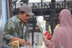 Selling Flowers at market. Residents buy flowers at Peterongan Market Semarang, Thursday June 14, 2018. The most delicious night flowers hunted by buyers of stock photos