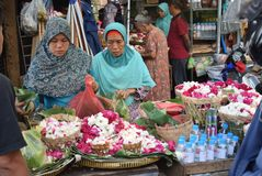 Selling Flowers at market. Residents buy flowers at Peterongan Market Semarang, Thursday June 14, 2018. The most delicious night flowers hunted by buyers of stock photography