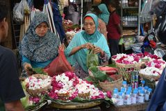Selling Flowers at market. Residents buy flowers at Peterongan Market Semarang, Thursday June 14, 2018. The most delicious night flowers hunted by buyers of stock image