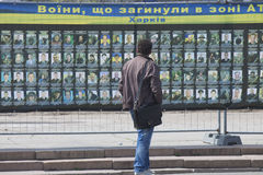 Residents of the city near the stand with photos of dead soldier Stock Photography