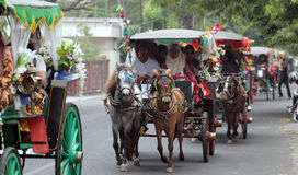 Residents convoy of carts. Using a traditional transportation using horsepower while the anniversary of national batik (2/10) Solo, Central Java, Indonesia Royalty Free Stock Photos