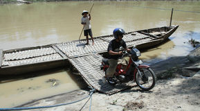 Residents crossing the river by boat solo canoe as a means of crossing to and from solo Central Java Indonesia. Stock Photo