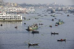 Residents of Dhaka cross Buriganga river by boats in Dhaka, Bangladesh. Royalty Free Stock Images
