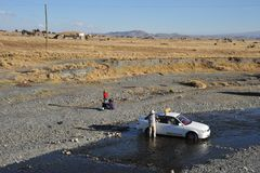 Residents of La Paz wash their cars in a mountain river in urban area Stock Image