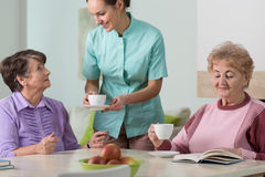 Residents of residential home. Caring nurse and residents of residential home Stock Photography