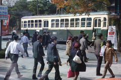 Residents of Seoul South Korea walk in front of preserved old traincar - Seoul South Korea- NOVEMBER 2013 Royalty Free Stock Photo