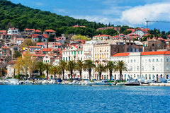 Residents and tourists walking along the shore in Split Stock Photos