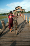 Residents and visitors traveling on the U-bein Bridge,Myanmar. Stock Images