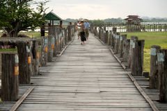 Residents and visitors traveling on the U-bein Bridge,Myanmar. Royalty Free Stock Photography