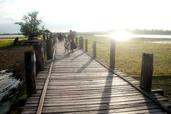 Residents and visitors traveling on the Uben bridge,Myanmar. Royalty Free Stock Photo