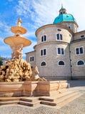 Residenzbrunnen with Salzburger Dom in Salzburg. Famous Residenzbrunnen with Salzburg Cathedral in the background on Residenzplatz in Salzburg, Austria stock images