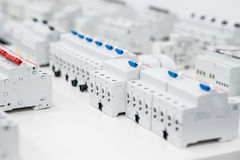 Residual current devices. Many residual current devices standing in a row on the table Stock Image