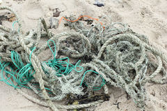 Residues of ropes and nets on the beach of Sylt Stock Photos