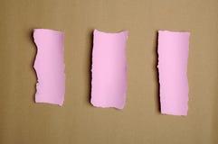 Residui di carta rosa lacerati Immagine Stock