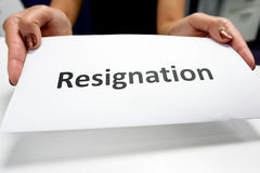 Resignation paper. Close up Resignation paper in a woman's hands Royalty Free Stock Photos