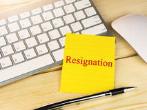 Resignation on sticky note. On work table Royalty Free Stock Image