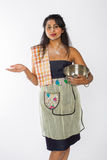 Resigned Indian Chef. A resigned looking female Indian chef with flour on her face and torso with a mixing bowl and whisk at her side Stock Images