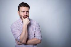 Resigned man on gray background. Isolated Royalty Free Stock Photo