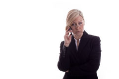 Resigned secretary with phone. Secretary looks angry and talking with handy Royalty Free Stock Photos