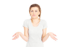 Resigned woman. A portrait of a pretty woman shrugging shoulders over white background Royalty Free Stock Images