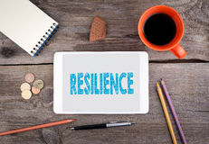 Resilience. Tablet device on a wooden table Stock Photos