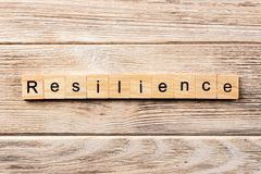 Resilience word written on wood block. resilience text on table, concept stock photos