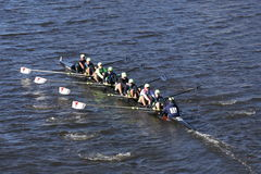 Resilient Rowing Club Crew races in the Head of Charles Regatta Men`s Youth Eight Stock Photo