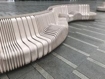 Resin benches on the square. Interesting geometric structure, are an ornament, but also have practical value royalty free stock photos
