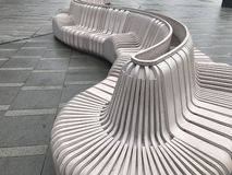 Resin benches on the square. Interesting geometric structure, are an ornament, but also have practical value stock images