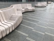Resin benches on the square. Interesting geometric structure, are an ornament, but also have practical value royalty free stock photo