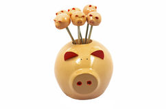 Resin pig as Fruit toothpick. On a white background Royalty Free Stock Photos