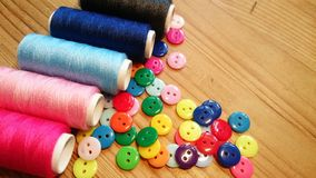 Resin Sewing Buttons and Threads royalty free stock photos