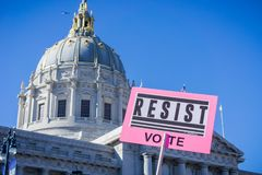 `Resist` sign raised at the Women`s March rally which took place in the Civic Center Plaza Stock Images