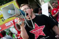 Resistance activist. An activist with a resistance t-shirt chants through a megaphone during the annual human rights march in Tel Aviv, Israel, December 7, 2012 stock photography