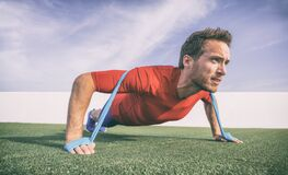 Free Resistance Band Pushup Fit Man Fitness Exercise With Rubber Bands Difficulty Royalty Free Stock Photos - 196069638