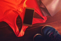 Resistance band, sports bra, sneakers and phone Royalty Free Stock Photography