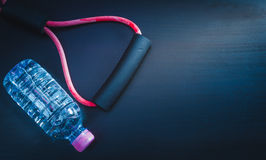 Resistance band and water bottle Royalty Free Stock Image