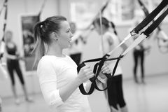 Resistance band workout. Young woman showing exercises with resistance band; fitness concept Stock Images