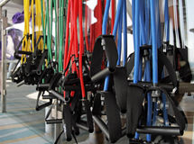 Resistance Bands Gym. Resistance bands color coded to weight hanging in a gym setting Royalty Free Stock Images