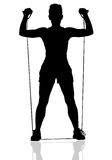 Resistance Press. Silhouetted Female Working out with a Resistance Band Royalty Free Stock Image
