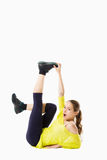 Resistant gymnast doing stretching exercises Royalty Free Stock Photography