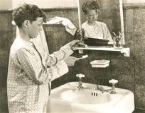 Resisting good oral hygiene habits Stock Image