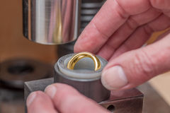 Resizing of wedding ring 1 Stock Photography