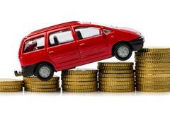 Resningbilen kostar. bilen myntar på Arkivbild