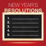 Resoluciones de s del Año Nuevo ': Lista de las metas en la pizarra con la parte posterior del rojo Fotos de archivo libres de regalías
