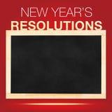 Resoluciones de s del Año Nuevo ': Lista de las metas en la pizarra con la parte posterior del rojo Imagen de archivo libre de regalías